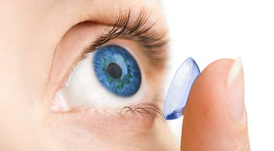 putting on contact lenses